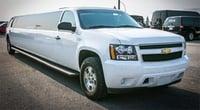 White Chevy Suburban Limousine