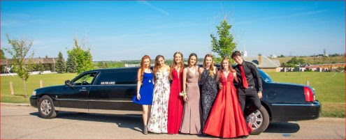 Graduation photo in front of black Lincoln Stretch Limousine
