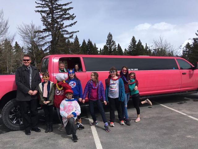Kids celebrating party with pink dodge ram limo