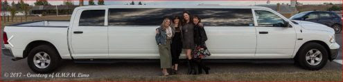 Family photo in front of white Dodge Ram Limousine