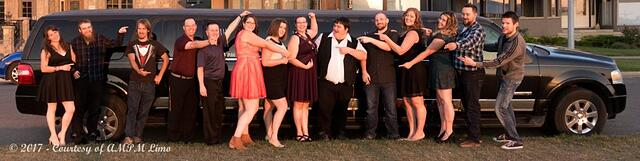 Birthday celebration photo in front of black Expedition Limousine