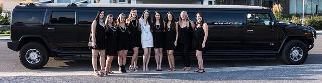 Bridal party photo in front of black Hummer limousine