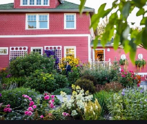 The Deane House with flowers outside in summer