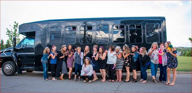 Stagette celebration photo in front of black Party Bus