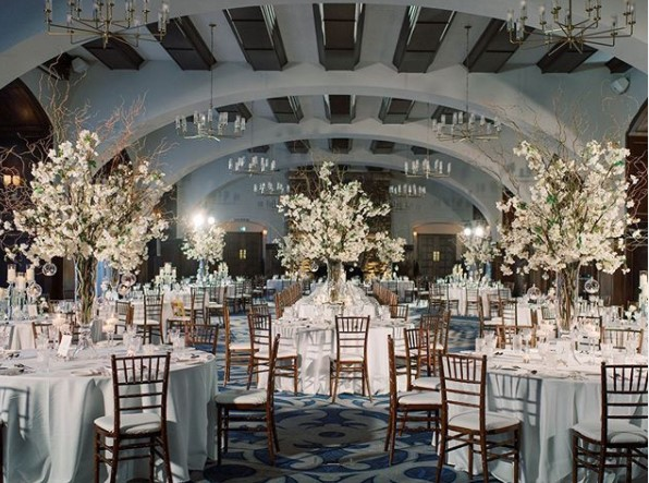 Photo of wedding reception area with tables and centerpieces set up