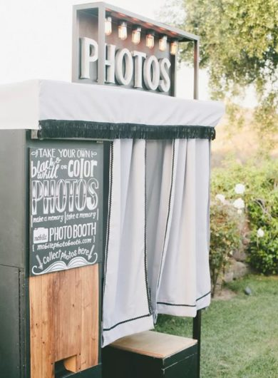 Wedding Photo booth outside in green grass