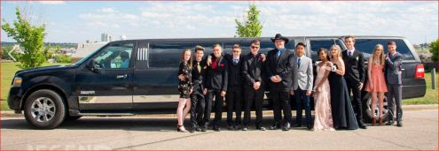 Wedding Party photo in front of black Expedition Limousine