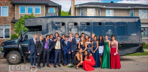 Group Grad Photo in front of Black Party Bus