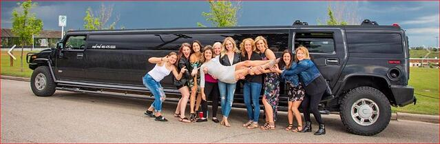 Group of ladies celebrating with black Hummer Limousine