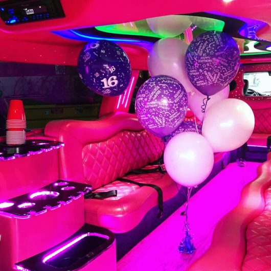 Birthday balloons inside the all pink Dodge Ram Limousine