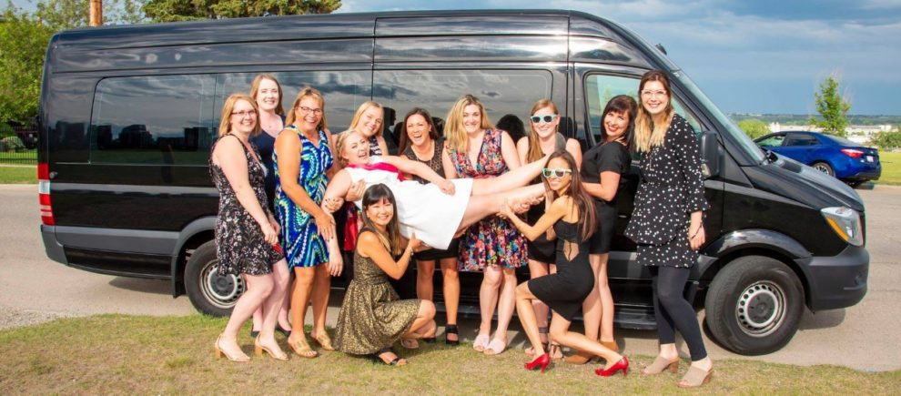 Stagette group photo with black mini Mercedes Party Bus